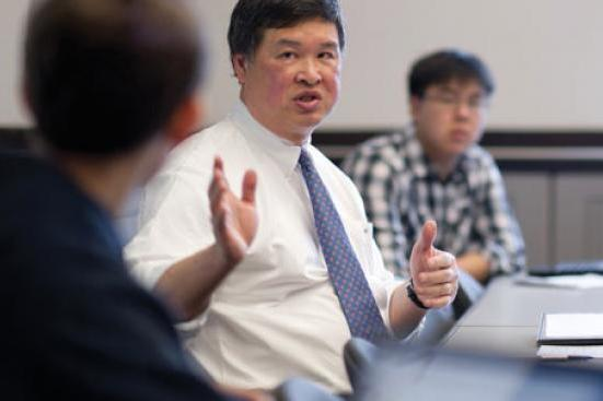 Photo of Denny Chin in a classroom
